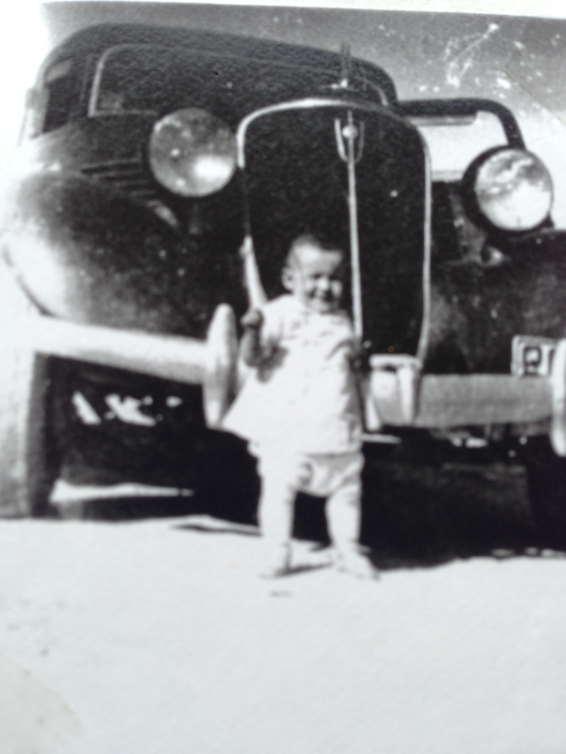 Becky baby in front of car