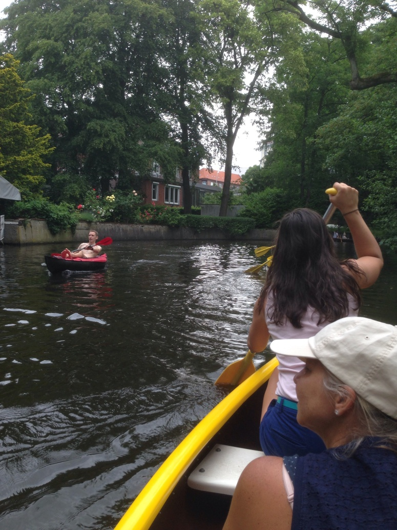 Canoeing under the treed canopy of the Alster River